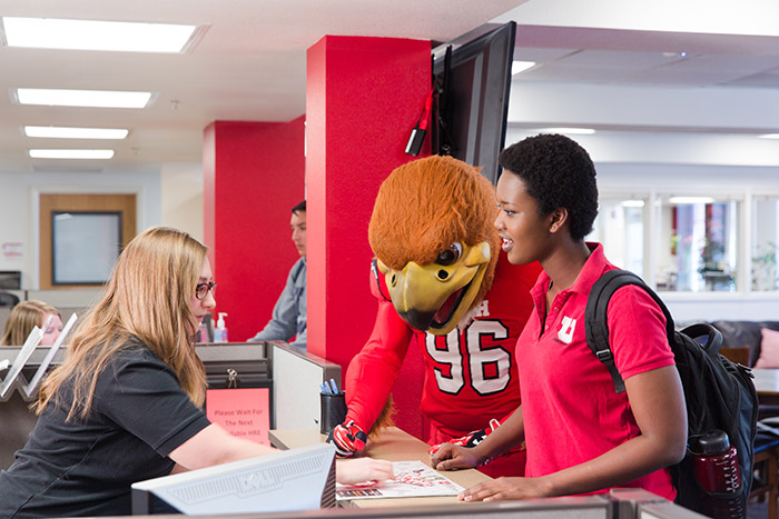 Student and Swoop being helped at the HRE central office
