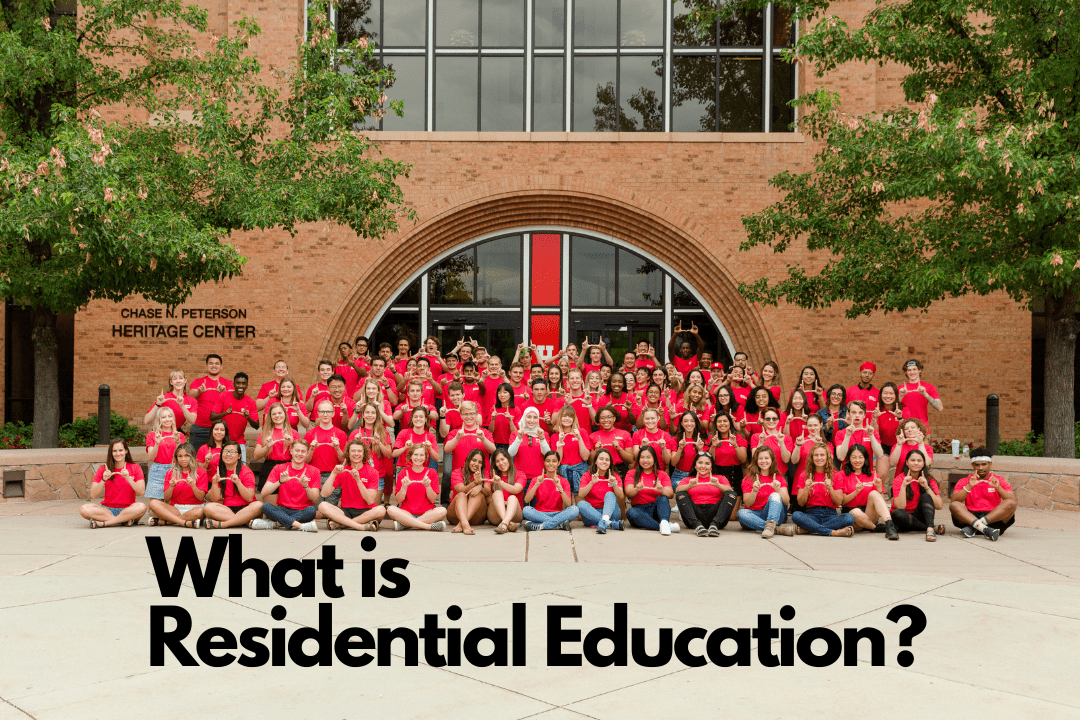 A large group of student leaders posed in front of the PHC with black text centered at the bottom reading What is Residential Education?